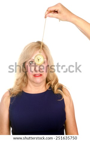a mature woman undergoes hypnosis by a trained doctor. isolated on white with room for your text - stock photo