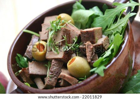 a meal of liver and rucola