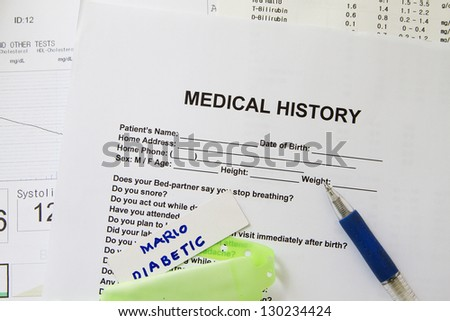 A medical history form with a green nametag. - stock photo
