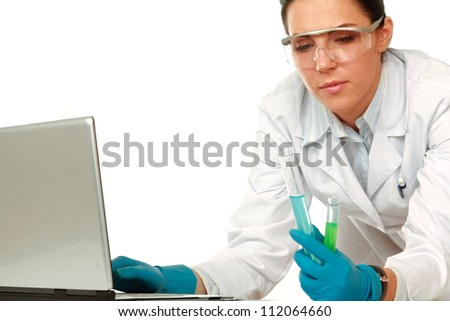 A medical or scientific researcher or doctor looking at a test tube , isolated on white background