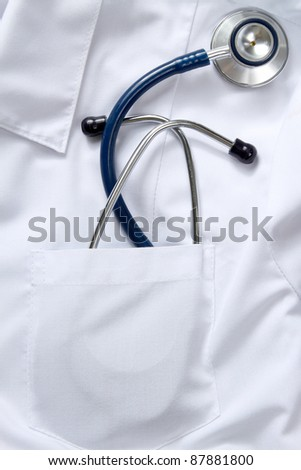 A medical stethoscope in the pocket of an overall, closeup