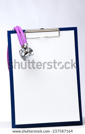 A medical stethoscope on a clipboard, isolated on white - stock photo