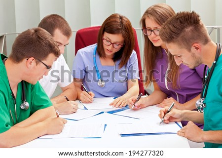 A medical team meeting in the hospitalhttp://admin.shutterstock.com/78625/review_batch.mhtml?queue_type=photo_queue&batch_url=%2Fbatches%2F1095413&code=5c89ee95382119860ddb4d481ed44b4d&account_id=1503659 - stock photo