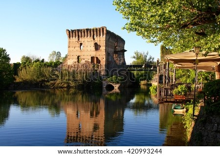 a medieval building upon the Mincio river in Borghetto, Verona, Italy