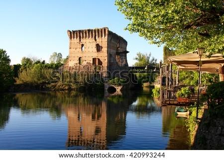 a medieval building upon the Mincio river in Borghetto, Verona, Italy - stock photo