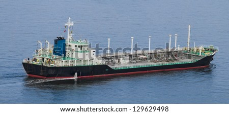 A medium sized chemical/liquid transport ship cruises across the bay. - stock photo