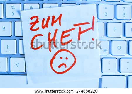 a memo is on the keyboard of a computer as a reminder: for chef - stock photo