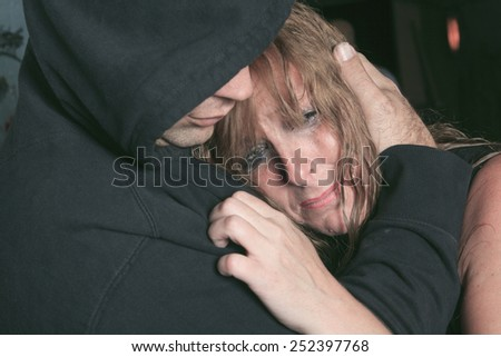 A men consoling woman and trying to calm down. - stock photo