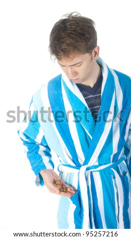 a men is getting up, some coins in his hand - stock photo