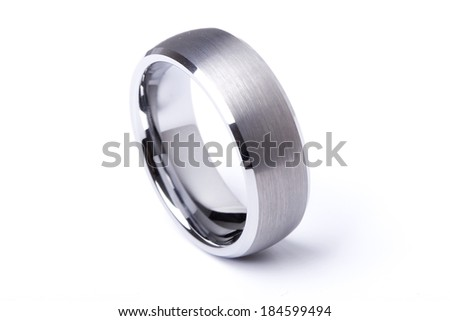A men plain wedding ring band made out of silver and gold on an isolated white studio background - stock photo