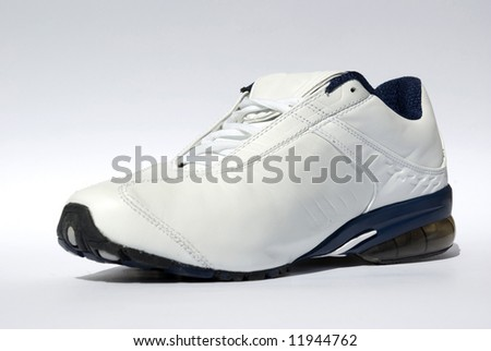 A men's running shoes on white - stock photo