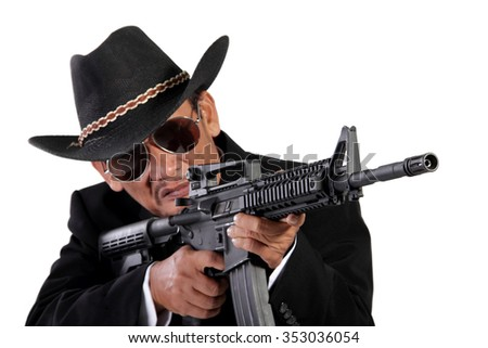 A menacing old gunman using his assault weapon, isolated on white background - stock photo