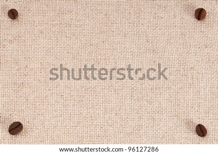 A menu board background with coffee beans on canvas - stock photo