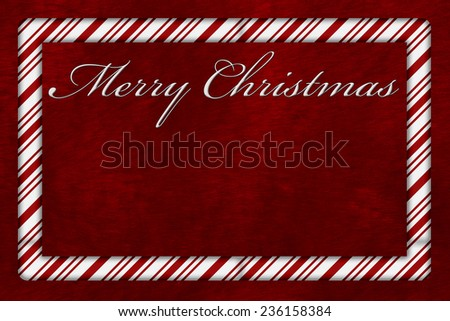 A Merry Christmas card, A Candy Cane border with words Merry Christmas over red plush background with copy-space - stock photo