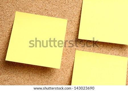 A message board background with yellow sticky notes on it.