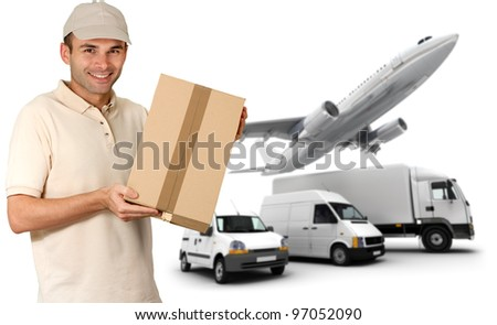 A messenger holding a package and a transportation fleet - stock photo