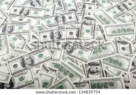 A messy carpet of 100 US$ money notes. - stock photo