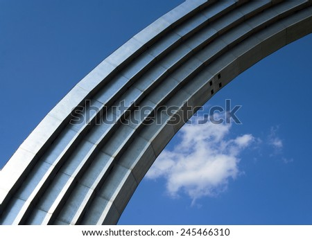 A metal arch on the sky background - stock photo