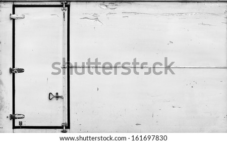 A metal door on the side of a cargo truck container.  - stock photo