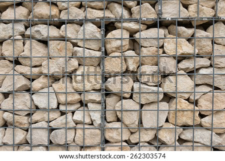 A Metal Fence Grid over Rock background