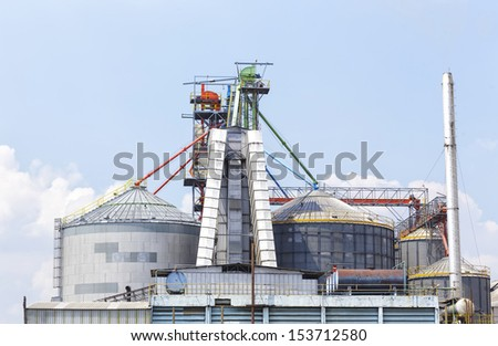 A metal grain facility with silos  - stock photo