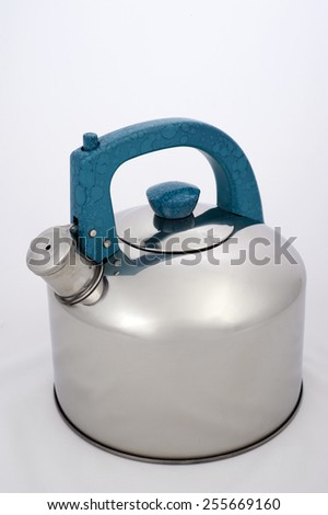 A metal kettle with a background in white