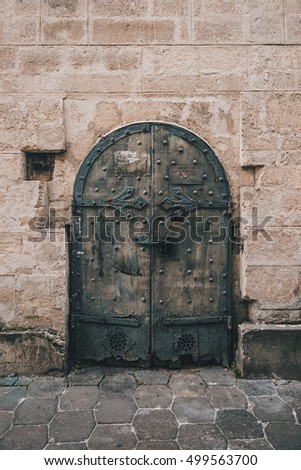 A metal old door of a stone wall. Lvov, Ukraine