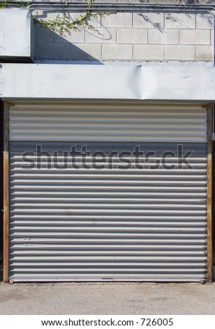 A metal rollup door protects a garage.