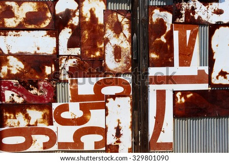 A metal wall with rusty numbers - stock photo