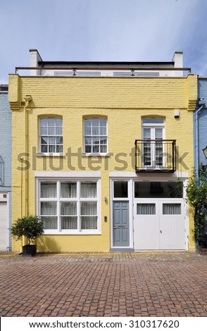 A mews house, converted from an 18th century stable carriage building, in  London. - stock photo