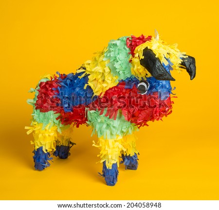 A mexican torro pinata  a yellow background - stock photo