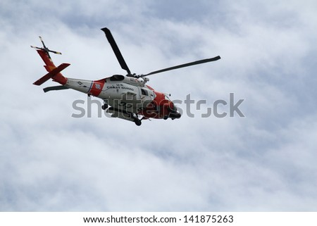A MH-60J Jayhawk Medium Range Recovery flying overhead