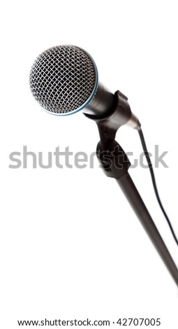 A microphone on the stand on a white background with copy space