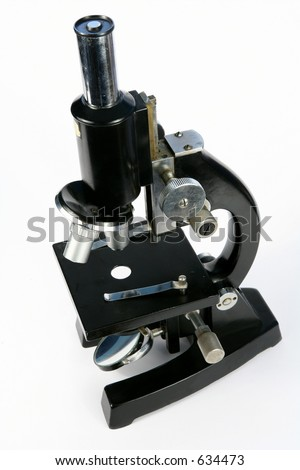 A mid-late 20th century microscope of the kind used for medical work or scientific research. - stock photo