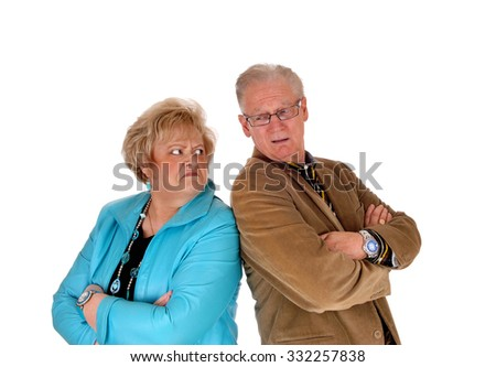 A middle age couple standing back to back are very angry at each other, isolated for white background.  - stock photo