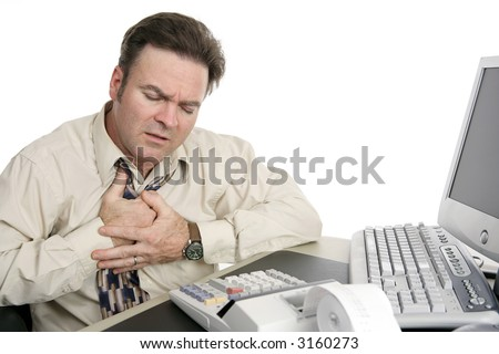 A middle aged man having chest pains or indigestion at work. - stock photo