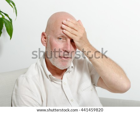 a middle-aged man with headache