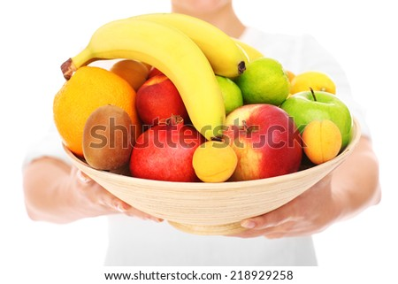 A midsection of a woman holding fruits over white background