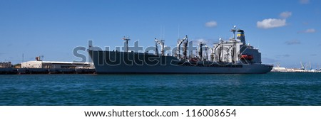 A military cargo ship at Pearl Harbor.