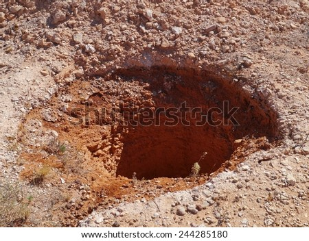 A mineshaft in Coober Pedy  at the Stuart Highway in South Australia - stock photo