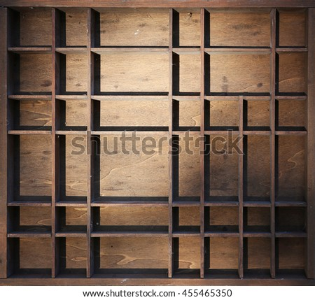 a miniature wooden shelf with dust and cobwebs in dramatic light  - stock photo