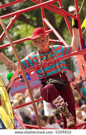 A 2007 Minnesota State Fair performer operates a giant wheel.