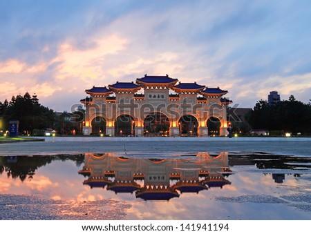 A mirror view of chiang kai shek memorial hall at night - stock photo