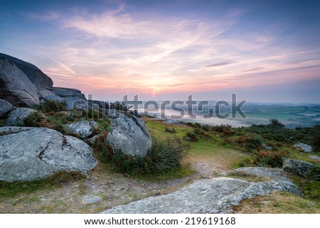 A misty morning sunrise at Helman Tor in Cornwall - stock photo