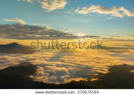 A misty morning sunrise on the mountain. - stock photo