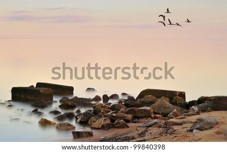 A misty sunset on the Chesapeake Bay in Maryland - stock photo