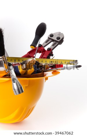 a mix of construction tools over a white background (selective focus) - stock photo