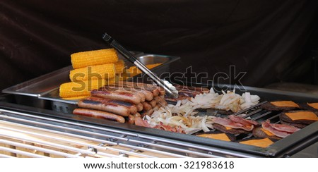 A Mix of Grilled Cooked Food on an Open Air Stove. - stock photo