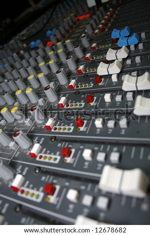 A mixing board viewed from a tilted angle.