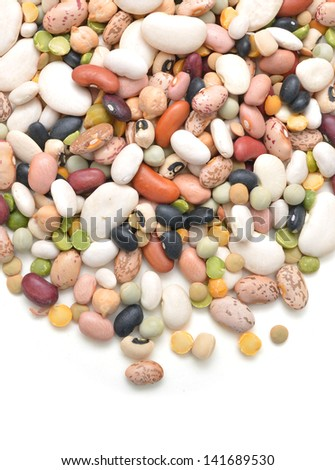 A mixture of legumes on background. - stock photo